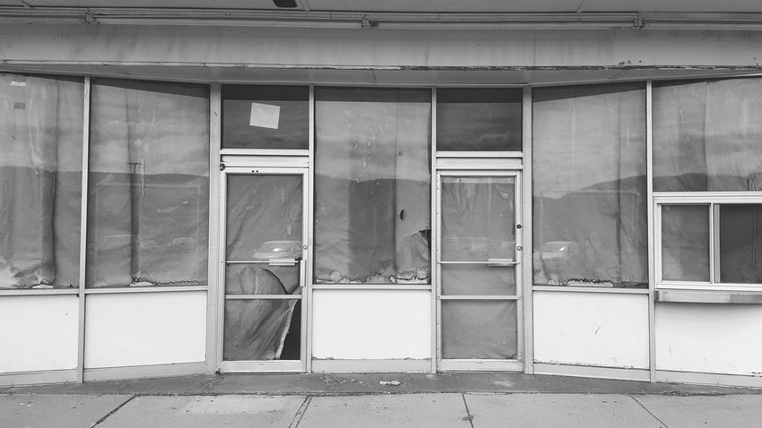 Closed Empty Covered Window Eyem_abandonment B&w Streetphotography Desolate Closed For Business Storefront Mystery Hidden View Monochrome Photography Manmadestructures Urbanexploration Building Exterior The City Light Minimalist Architecture Long Goodbye Rethink Things