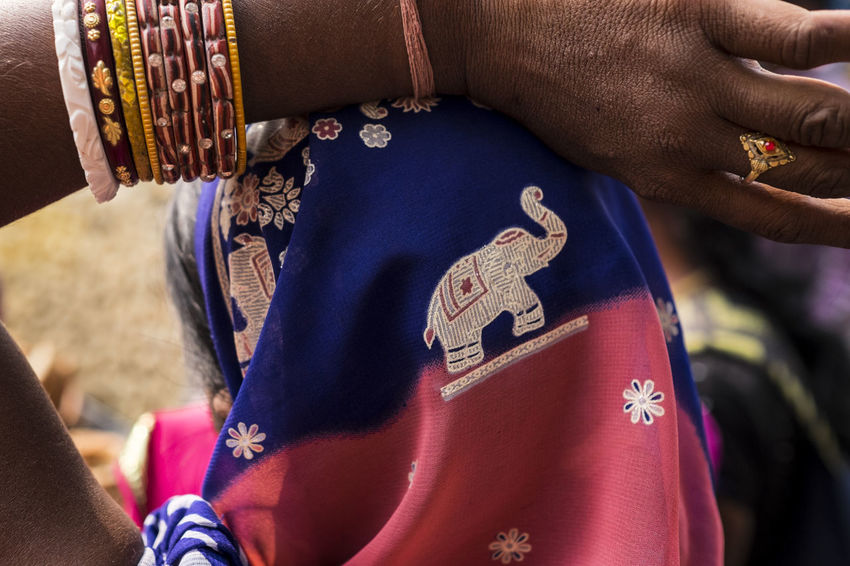 Detail shot of an embroidered head scarf. Sonepur Mela, Bihar Bangles Bihar Blue Elephant Embroidery Gold Hajipur Headscarf Human Hand India Jewellery Outdoors Pink Color Scarf Sonepur Sonepurmela Tradition Traditional Traditional Clothing Travel Travel Photography