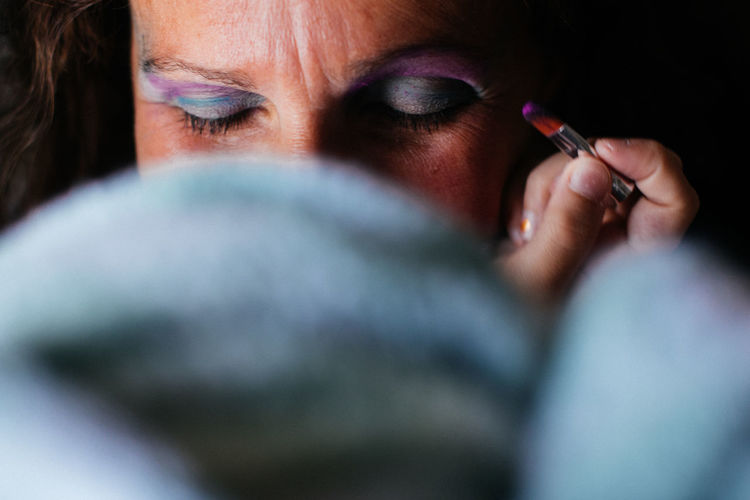 Cropped Image Of Woman Applying Eyeshadow