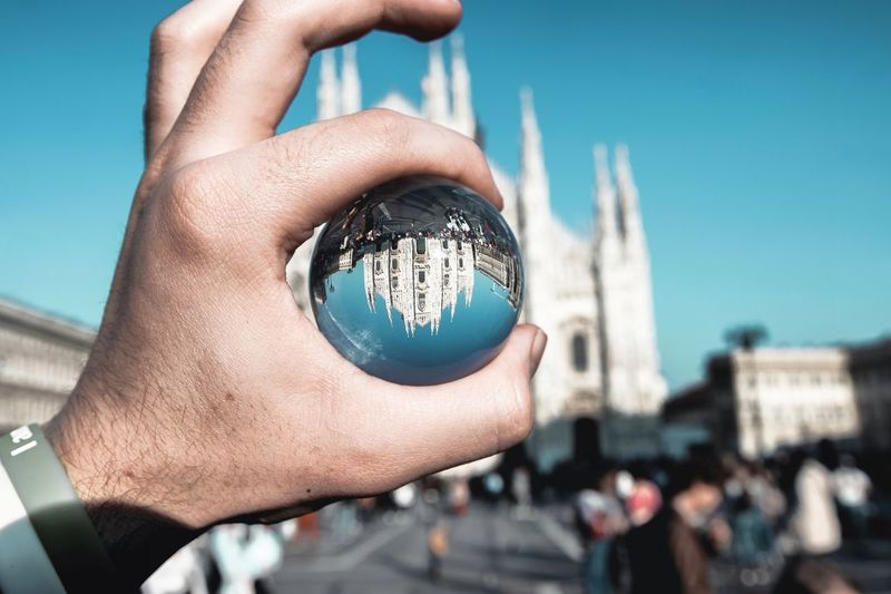 Milano Design Week Hand Human Hand Holding One Person Human Body Part Focus On Foreground Sky Personal Perspective Building Exterior Unrecognizable Person Nature Finger Human Finger Built Structure Real People Body Part Architecture Close-up Day City