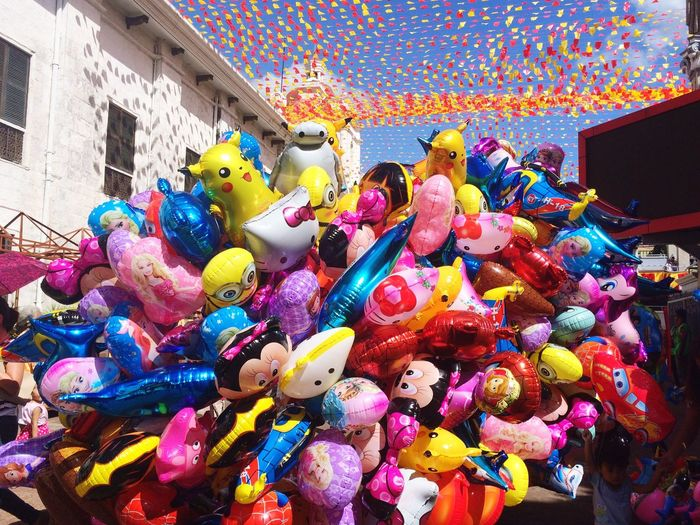 Multi Colored Celebration Balloon Large Group Of People Crowd Leisure Activity Men Women Architecture Day Outdoors Tree Sky People Clown Holi Adult
