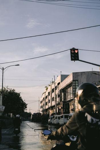 People on street against sky in city