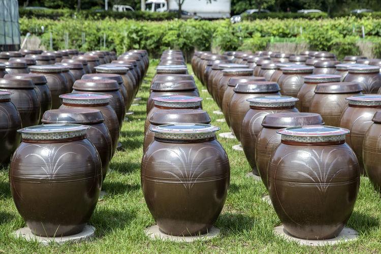 Pottery arranged on grassy field