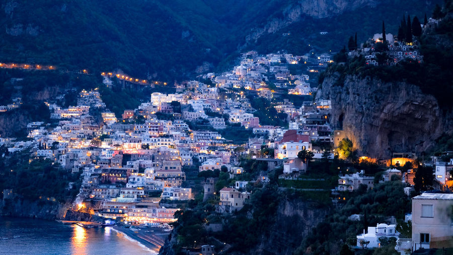 A spring evening falls upon the beautiful city of Positano, Amalfi coast, Italy. Architecture Building Exterior City Illuminated Built Structure Cityscape Building Nature Water Residential District Mountain Crowd Night Dusk Crowded High Angle View Outdoors Mountain Range TOWNSCAPE Positanocoast Positano Italy Evening Light City Life Cityscape My Best Photo