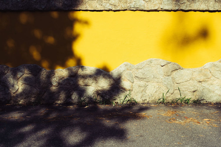Threeweeksgalicia Architecture Built Structure No People Day Sunlight Shadow Nature Yellow Wall - Building Feature Wall Outdoors Textured  Close-up City Pattern Solid Plant Road Transportation Street Stone Wall Surface Level