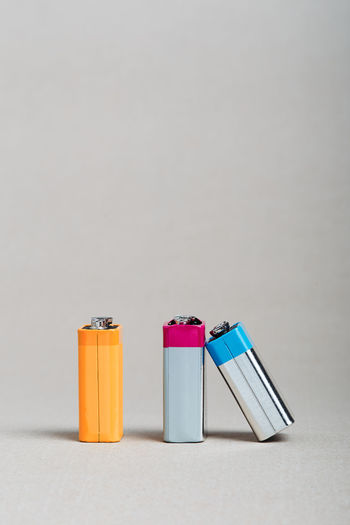 Close-up of battery in container against white background