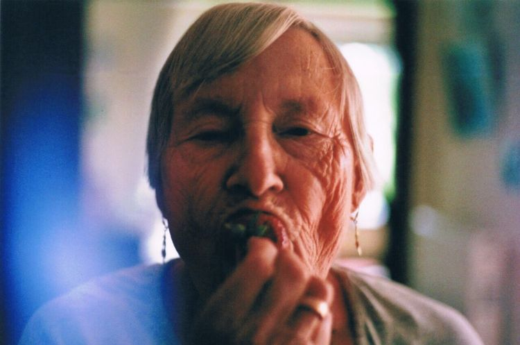 EyeEm Selects Senior Woman Strawberry Grandma One Woman Canon 35mm 50mm 1.8 Portrait Senior Adult One Person Real People Front View Headshot Indoors  Close-up Lifestyles Adult People Adults Only Canon Ae 1