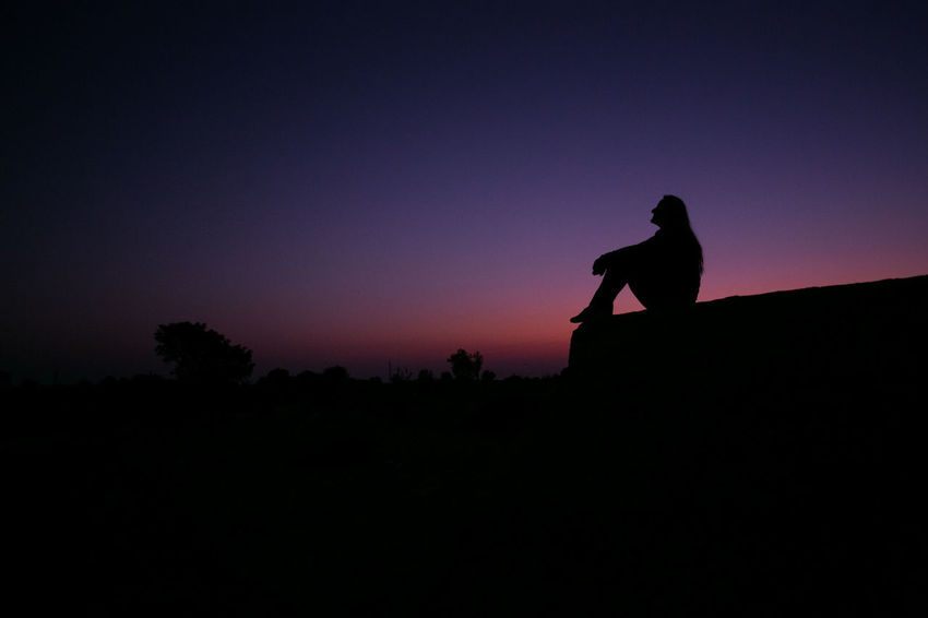 Alone From Dusk Till Dawn India Meditation Rock Thinking Woman Beauty In Nature Copy Space Dusk Land Leisure Activity Lifestyles Nature One Person Outdoors Real People Scenics - Nature Side View Silhouette Sitting Sky Tranquil Scene Tranquility Traveler #FREIHEITBERLIN The Great Outdoors - 2018 EyeEm Awards The Traveler - 2018 EyeEm Awards The Photojournalist - 2018 EyeEm Awards Summer Road Tripping HUAWEI Photo Award: After Dark