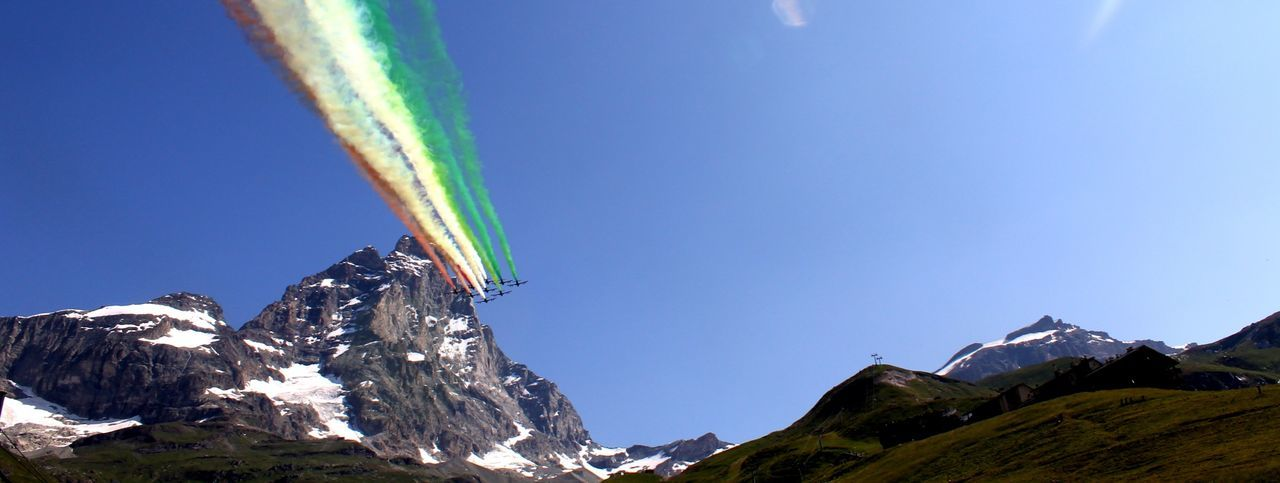 Frecce Tricolori, the Italian Air Force aecrobatic team flying over the Matterhorn.