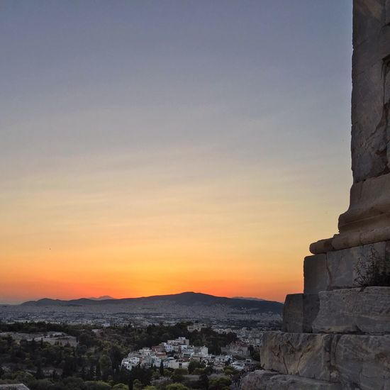 Acropolis at dusk Sunset Orange Color Architecture Built Structure No People Sky Mountain Nature Outdoors Beauty In Nature Scenics Building Exterior Day Tourism After Sunset Sky Colorful Sunset The Week On EyeEm Athens, Greece Beauty In Nature Tranquil Scene Travel Destinations Ancient Architecture Cityscapes City Overlook