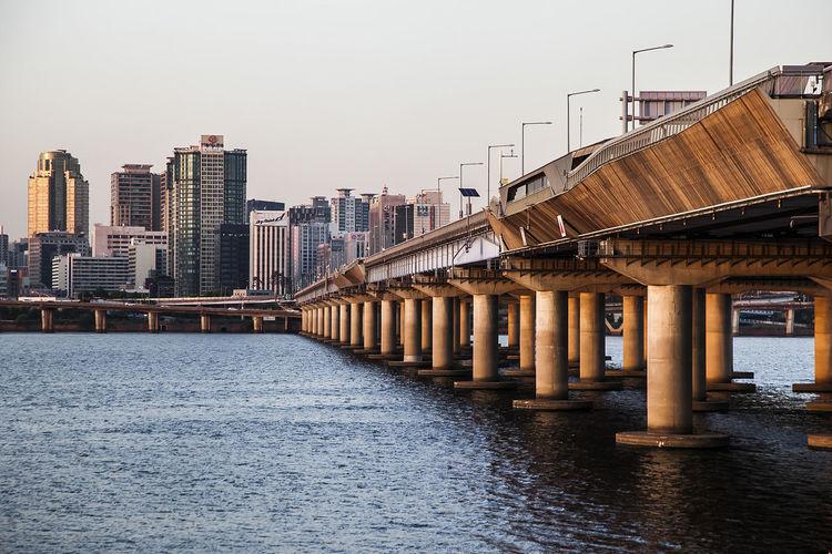 Mapo bridge over han river in city against sky