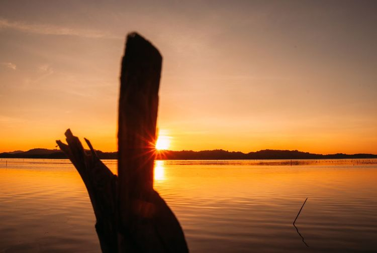 Sunset flare🌅 Sabahtourism Mengkabong River Kotakinabalu Silhouette_collection Malaysiaphotographer Tuaran Hsphoto Sunset Silhouettes Sunset Naturelover Sabahphotographer Sunset Sky Water Orange Color Beauty In Nature Scenics - Nature Tranquility Nature Sun Silhouette