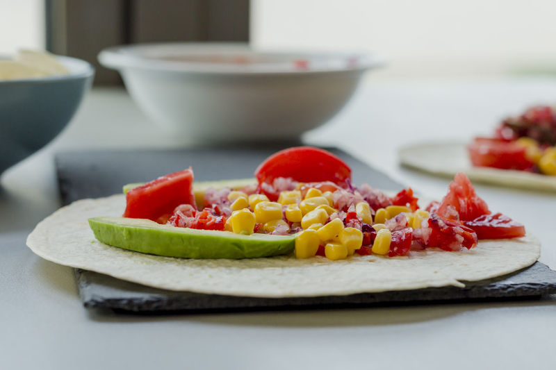 Tacos Homemade Food And Drink Food Freshness Plate Healthy Eating Fruit Vegetable Table Indoors  Close-up Ready-to-eat Wellbeing No People Still Life Selective Focus Focus On Foreground Serving Size Bowl Tomato Red Tray Fruit Salad Snack
