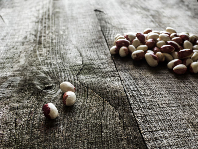 Kidney beans on wood table background. Protein nutrition. Acorn Arrangement Beans Food Food And Drink Four Objects Fragility Freshness Group Of Objects Healthy Eating In A Row Kidney Nutrition Protein Selective Focus Side By Side Table Wood Wood - Material Wooden