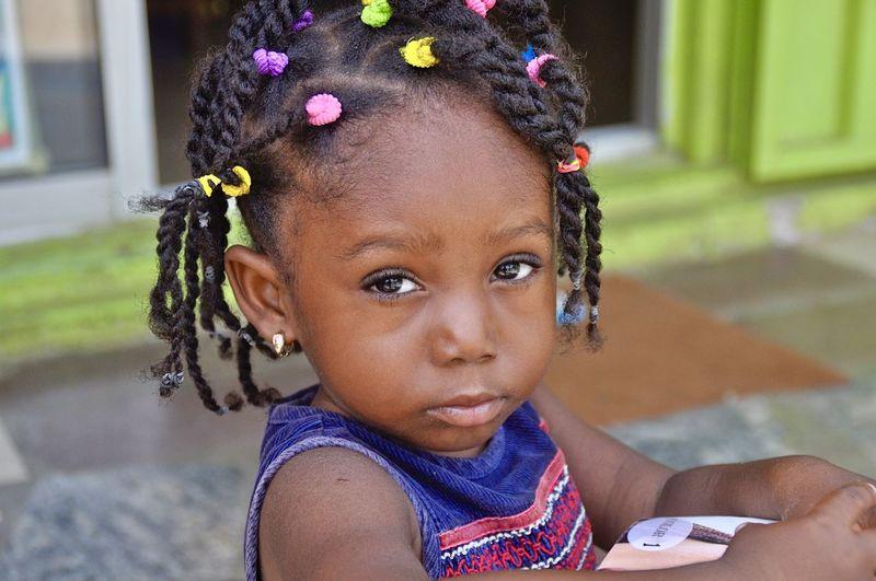 Portrait Of Cute Girl On Sidewalk