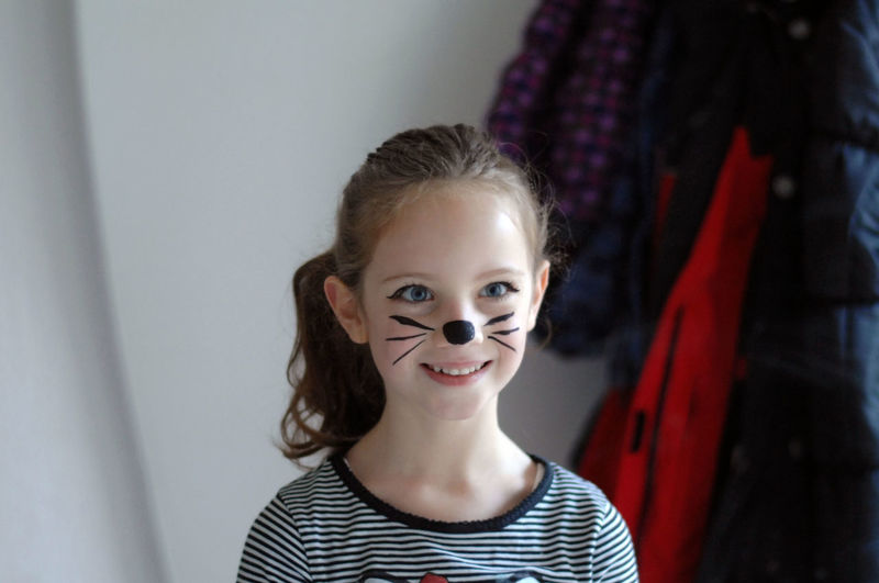 Smiling Girl With Face Paint Looking Away