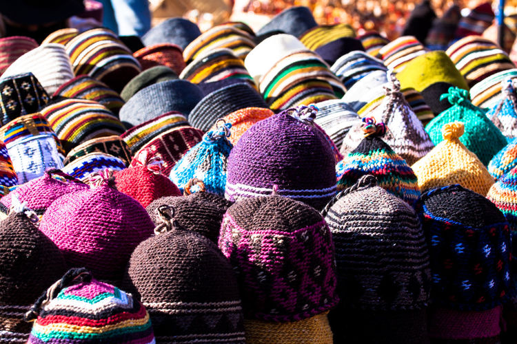 Marrakesh, Morocco. A local market stall selling colorful knitted hats of different shapes and kinds. Africa Arab Arabic Clothing Colorful Colors Culture Hat In A Row Knitting Large Group Of Objects Lifestyles Market Stall Marketplace Marrakech Marrakesh Morocco Multi Colored Repetition Side By Side Tradition Traditional Culture Travel