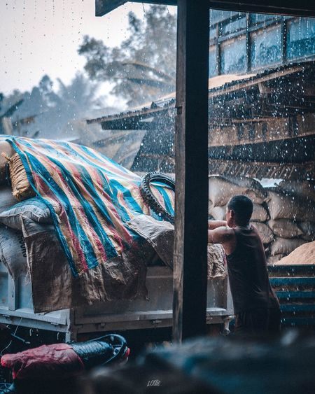 Sudden heavy rain EyeEm Selects Philippines Pilipinas Asian  Rain Window Architecture Glass - Material Day Built Structure Multi Colored Building Exterior Transparent Nature Outdoors Real People People Men Water