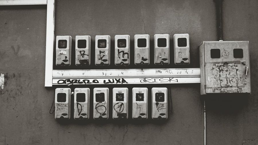 Close-up of electrical equipment on wall