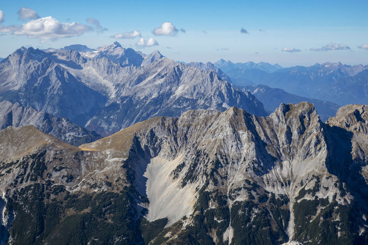 Zugspitze Zugspitze Mountain Beauty In Nature Scenics - Nature Environment Sky Mountain Range Tranquil Scene Landscape Non-urban Scene Mountain Peak No People Nature Tranquility Idyllic Day Cold Temperature Cloud - Sky Rock Snow Travel Formation Outdoors Snowcapped Mountain Range High