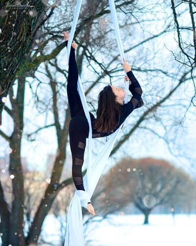 Outdoors Day Water Tree Young Adult Happiness One Person Smiling Hanging Gripping Branch Young Women One Young Woman Only One Woman Only Sky Acrobatic Activity Sport Aerial Aerial Silks