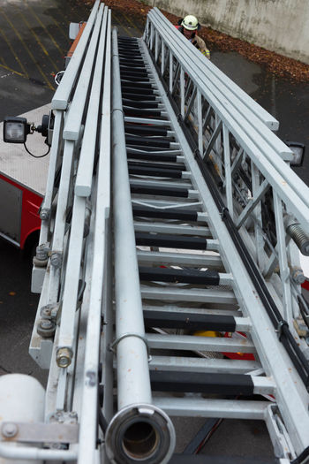 FireFighting  Firefighter Firefighter Truck Ladder Red Aerial Ladder Architecture Basket Blue Blue Light Built Structure Close-up Day Fire Firebrigade Firefighter Equipment Firefighters Firefighters In Action Go-west-photography.com High Angle View No People Outdoors Steps And Staircases Transportation Turntable Ladder