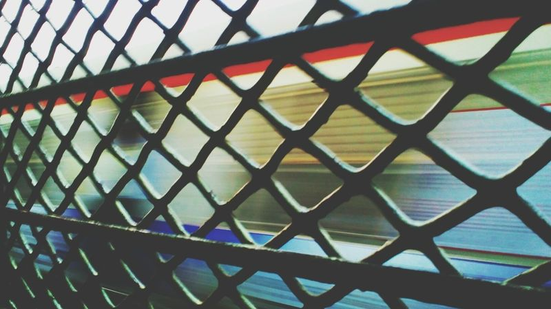 Chainlink Fence Safety Crisscross Chainlink Pattern Metal Full Frame MotoClick Beginner Mobilephotography Beginnerphotographer Backgrounds Railroad Station Platform Window Public Transportation Rail Transportation Indiantrains Railroad Track Train - Vehicle Transportation Mode Of Transport Leisure Activity Neon Life EyeEmNewHere EyeEm Selects