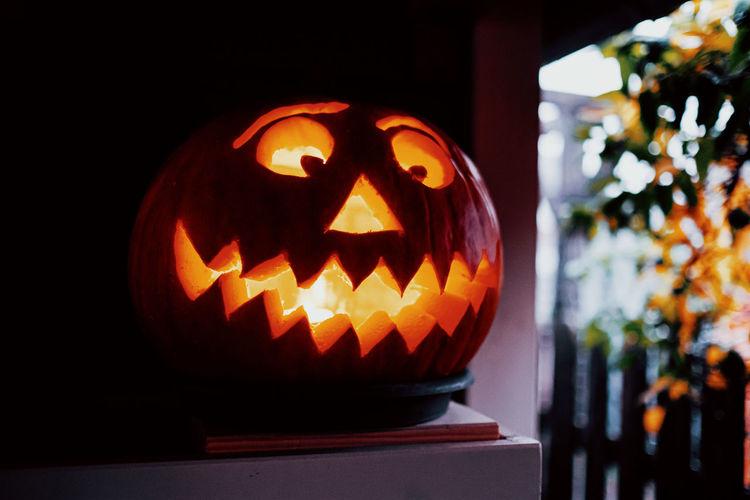 Illuminated candles on pumpkin