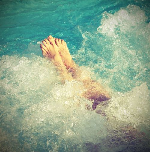 Woman in spa pool and whirlpool at her feet with vintage effect Care Females Leg Woman Abano Abano Terme Girl Healthy Eating High Angle View Hotel Hydromassage Hydrotermal Hydrotherapy Legs One Person People Real People Resort Sea Swimming Thermal Therme Water Waterfront Woman Portrait