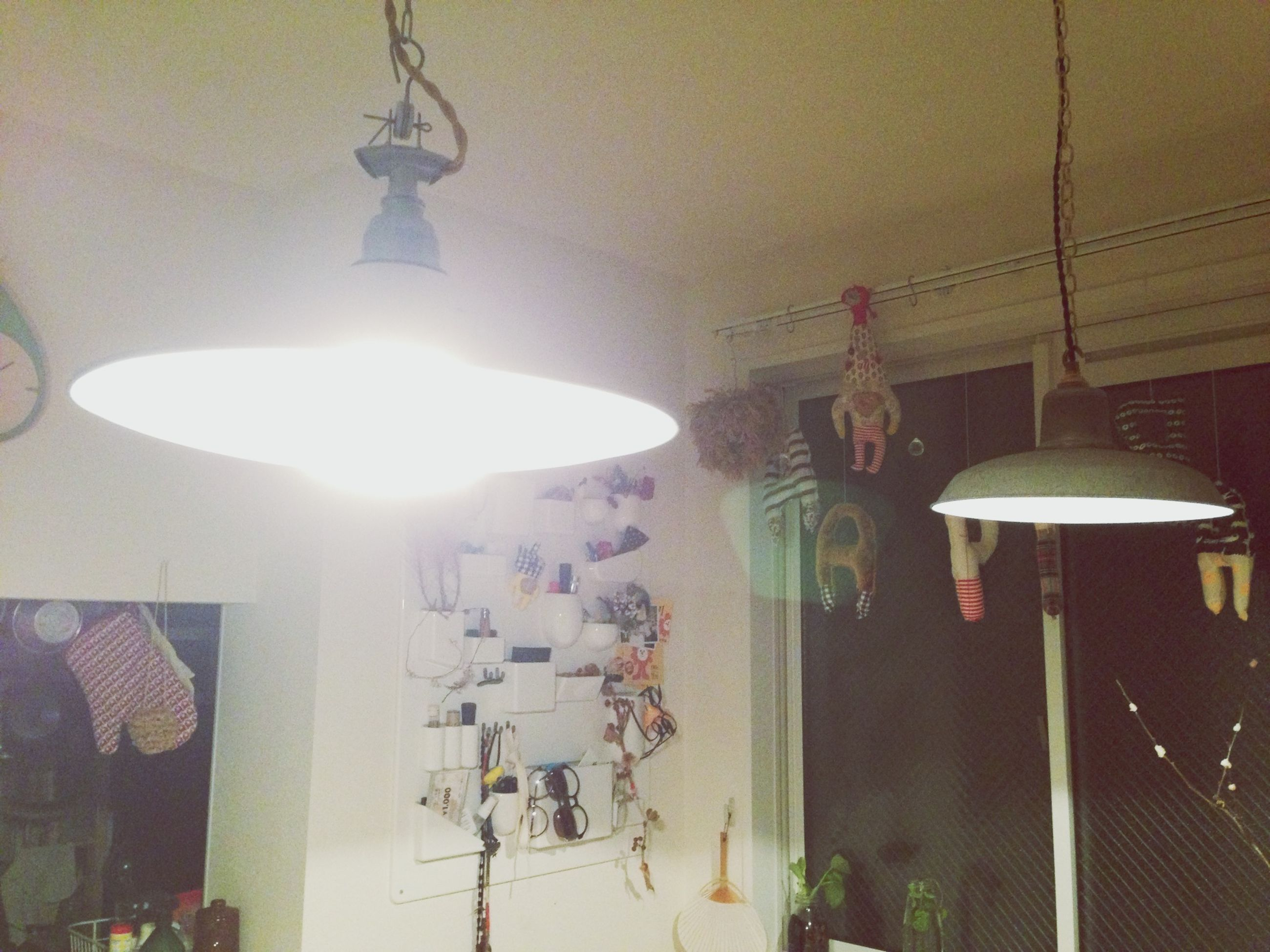 indoors, lighting equipment, illuminated, hanging, electric lamp, ceiling, electricity, electric light, lamp, chandelier, decoration, built structure, lantern, home interior, light - natural phenomenon, architecture, religion, light bulb, low angle view, lit