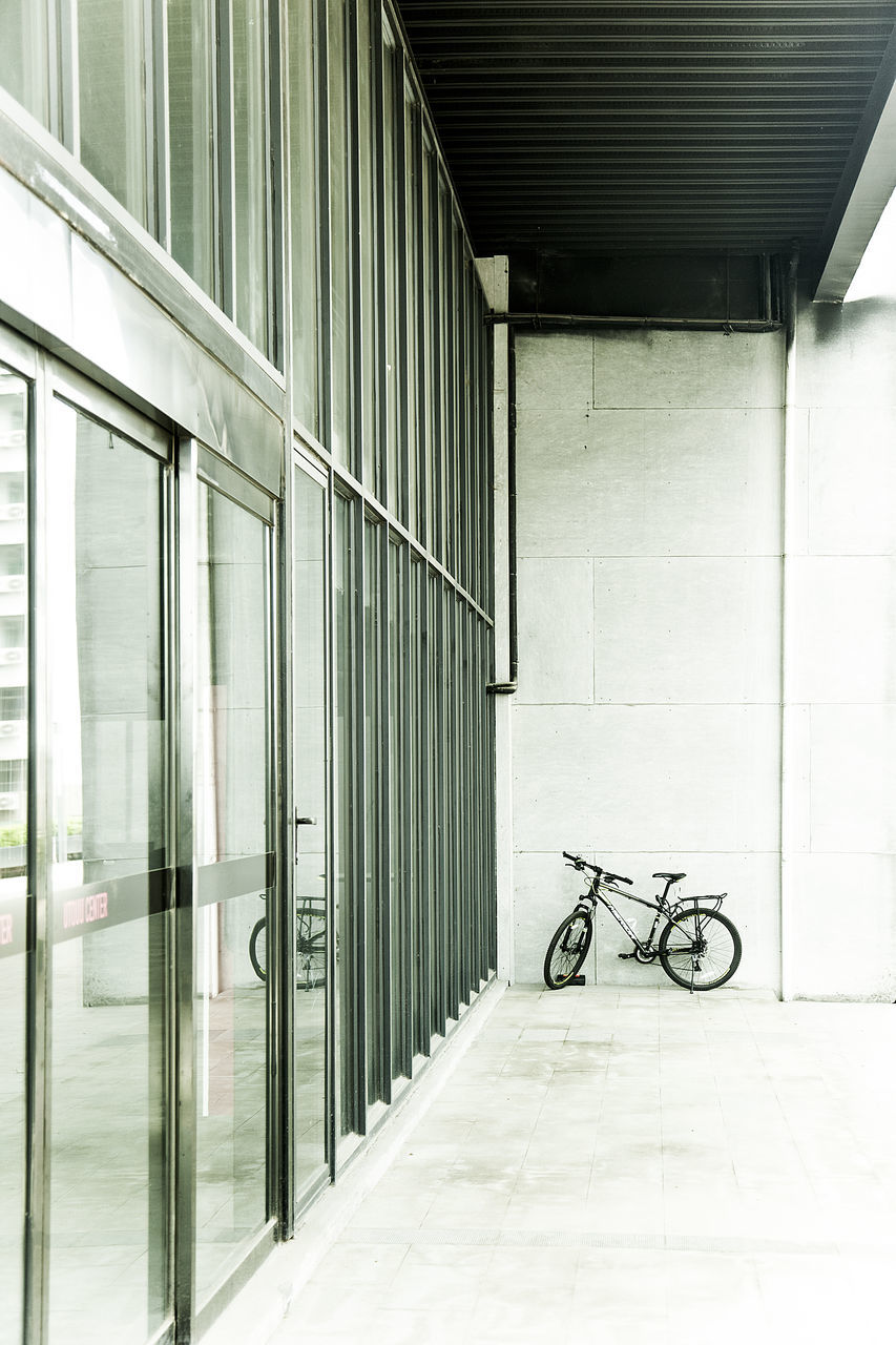 bicycle, transportation, mode of transport, indoors, architecture, stationary, built structure, no people, day, bicycle rack