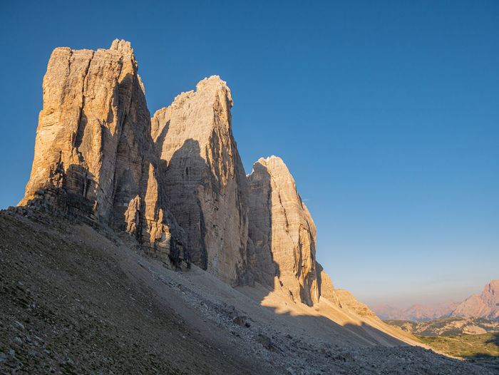 Rock formations on mountain against clear sky