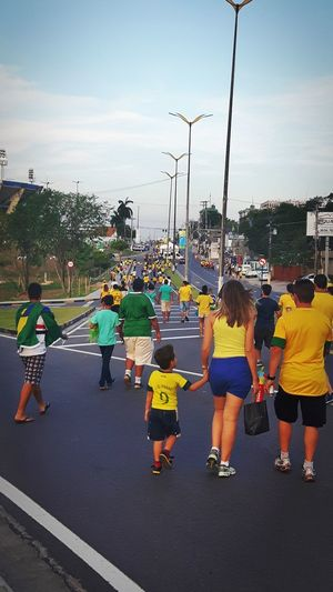 People walking to Arena da Amazônia to watch the female soccer match in the Olympic Games. Brazil x South Africa Soccer Olympicgames2016 Crowd People Crowd People Walkingcrowd Street Photography Brazilian ARENADAAMAZONIA Walking Olympicgames