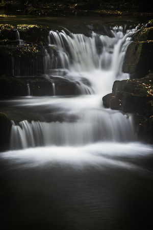 Waterfall in the forest Copy Space EyeEm Best Shots Beauty In Nature Blurred Motion Environment Falling Water Flowing Flowing Water Forest Land Long Exposure Motion Nature No People Outdoors Power In Nature Scenics - Nature Tourism Destination Travel Destinations Visit Wales Water Waterfall