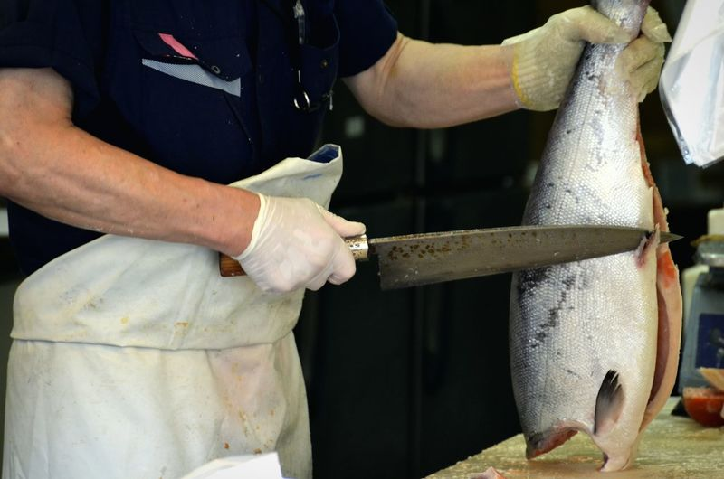 Person cutting fish