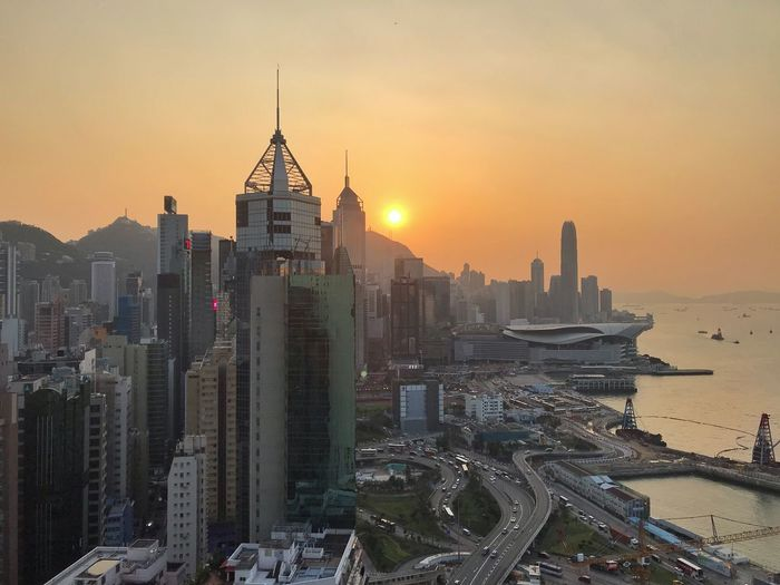 Sunset over Hong Kong Hong Kong Building Exterior Architecture Built Structure Building City Office Building Exterior Cityscape Sky Sunset Skyscraper Travel Destinations High Angle View Outdoors No People Urban Skyline The Traveler - 2019 EyeEm Awards The Mobile Photographer - 2019 EyeEm Awards
