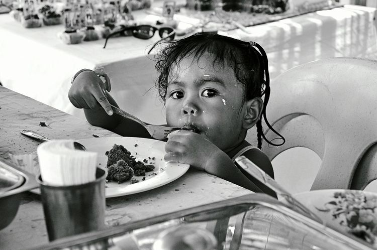 Real People Child Childhood Close-up Eating Time Enjoying Food Little Girl Portraits Black And White Photography Looking At Camera Capture The Moment The Week On EyeEm EyeEmNewHere