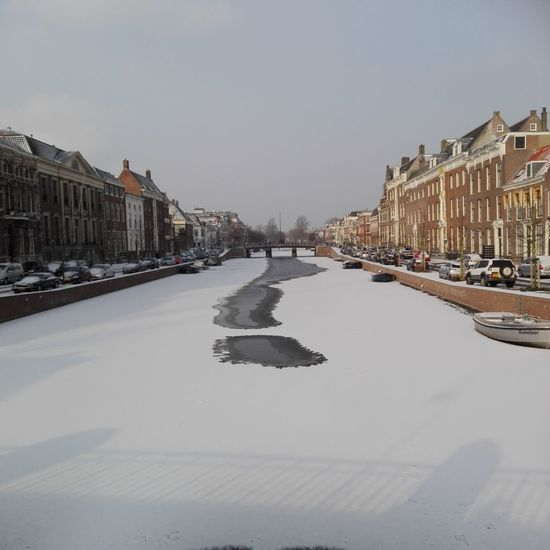 This morning, de Nieuwe Gracht in Haarlem Haarlem Morning Morning Light Dutch Canals Canal Snow Snowy Snowy Days... Frozen Frozen Canal Netherlands Nederland Holland Hollande Houses Water Haarlem Huawei HuaweiP8 Cold Winter Glaglagla Winter Sky Architecture City Outdoors No People Day Cityscape