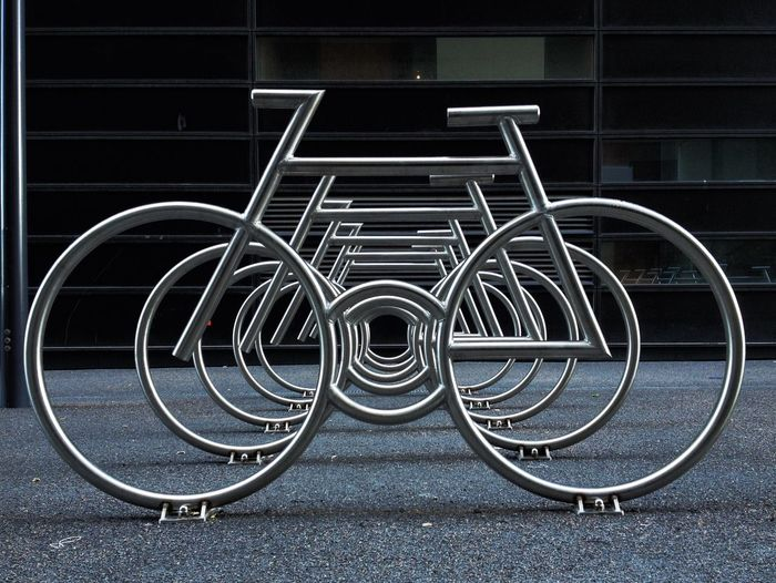 Bicycle Rack Against Building In City