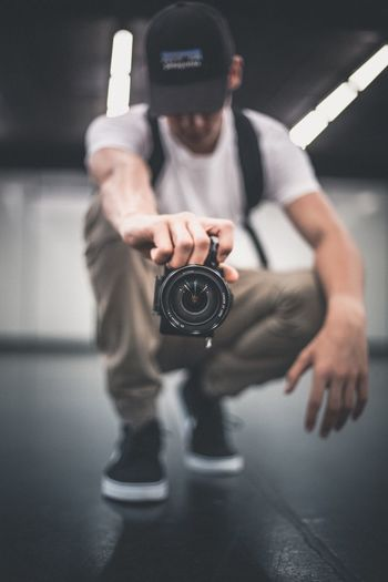One Person Indoors  Technology Men Leisure Activity Real People Holding Camera - Photographic Equipment Lifestyles Full Length Young Adult Photography Themes Day People