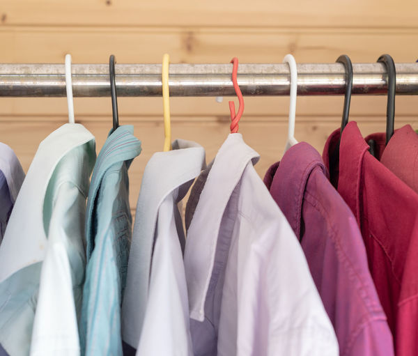 Colourful men's shirts hanging on rack Button Down Shirt Choice Close-up Closet Clothes Rack Clothing Coathanger Furniture Garment Group Of Objects Hanging In A Row Indoors  Large Group Of Objects Metal Multi Colored No People Order Purple Rack Side By Side Textile Variation