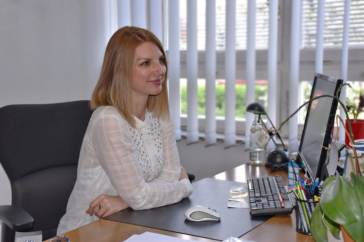 Woman sitting at computer desk