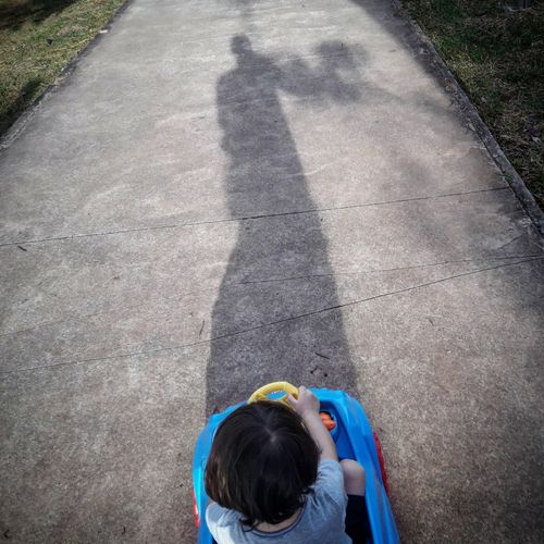 Rear view of boy playing on playground