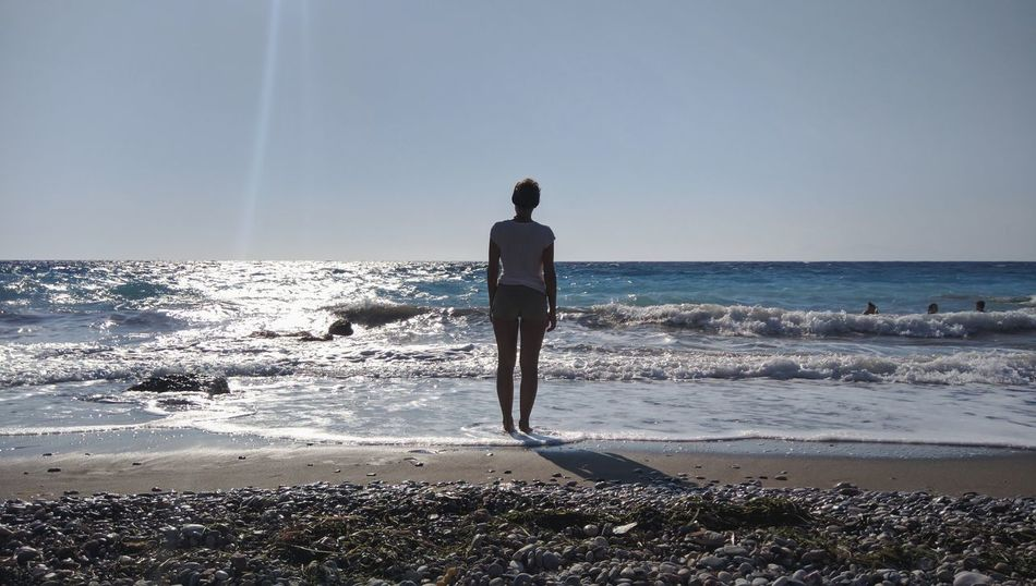 Sea Beach One Person Full Length Horizon Over Water Rear View Adults Only Adult Water People Vacations Sand Silhouette Sky Day Casual Clothing Wave Girl Alone On The Beach Only Women Women Sillouette Tranquility