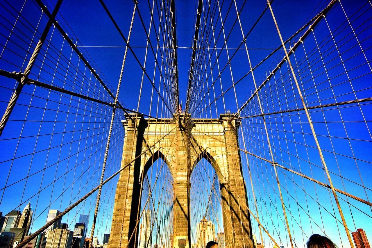 Architectural Detail Of Brooklyn Bridge Against Clear Blue Sky