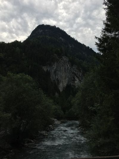 Somber river mood Wild Nature Mountains River Outdoors Outdoor Photography Mountain Water Cloud - Sky Alps Naturelovers Unedited Nofilter Forest Nature Photography Beautiful Nature