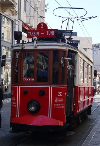 Red Transportation Mode Of Transportation City Street Land Vehicle Architecture Cable Car Building Exterior Public Transportation Built Structure Day Text Communication Accidents And Disasters Road Incidental People Nature Sign Travel