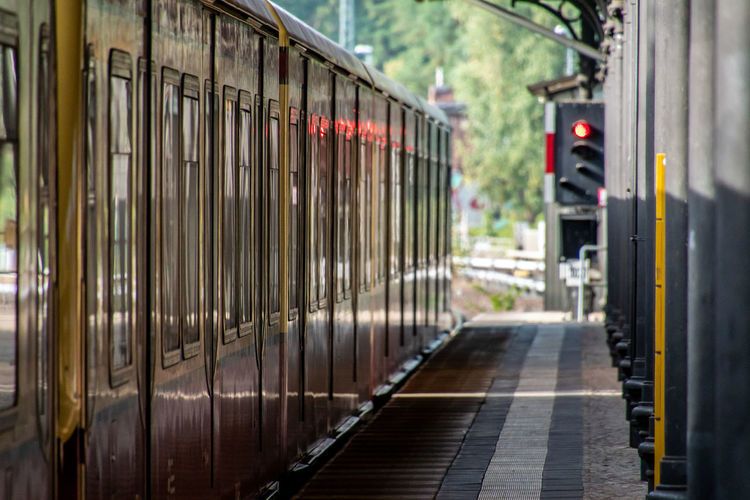 Train on railroad station platform in city