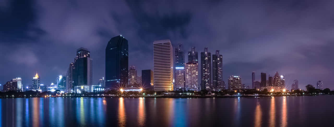 Architecture Building Exterior Built Structure City Cityscape Illuminated Modern Night No People Outdoors Reflection Sky Skyscraper Travel Destinations Urban Skyline Water Waterfront
