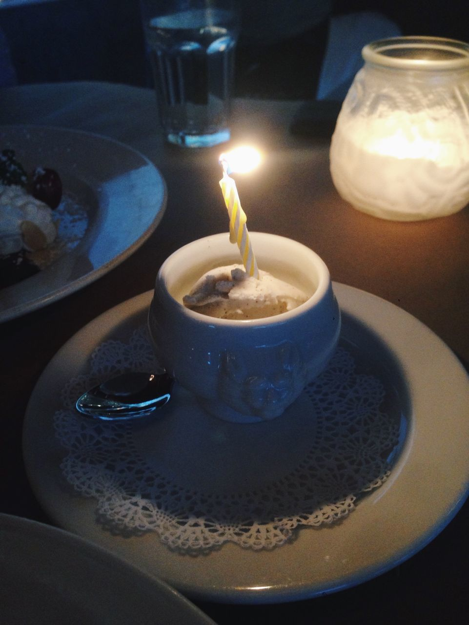 Food And Lit Candles On Table